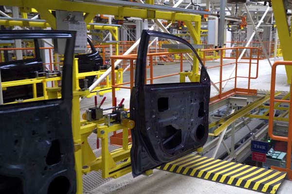 Automobile Doors Being Assembled